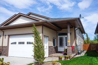 Photo 1: 21 Destiny Way: Olds Semi Detached for sale : MLS®# A1018668