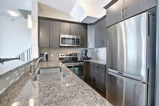 Photo 12: 2407 15 SUNSET Square: Cochrane Apartment for sale : MLS®# A1072593