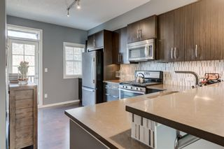 Photo 5: 440 Ascot Circle SW in Calgary: Aspen Woods Row/Townhouse for sale : MLS®# A1090678