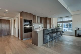 Photo 5: 501 128 Waterfront Court SW in Calgary: Chinatown Apartment for sale : MLS®# A1107113