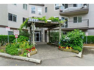 "Photo 1: 208 33480 GEORGE FERGUSON Way in Abbotsford: Central Abbotsford Condo for sale in ""CARMONDY RIDGE"" : MLS®# R2392370"