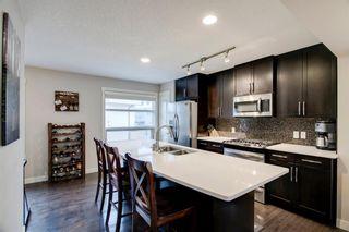 Photo 13: 35 ASPEN HILLS Green SW in Calgary: Aspen Woods Row/Townhouse for sale : MLS®# A1033284