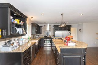 Photo 4: 8738 143A Street in Surrey: Bear Creek Green Timbers House for sale : MLS®# R2606825