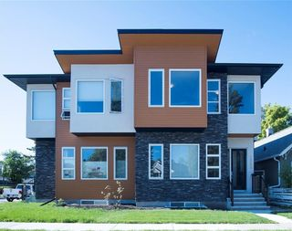 Main Photo: 2303 5 Avenue NW in Calgary: West Hillhurst Semi Detached for sale : MLS®# A1097502
