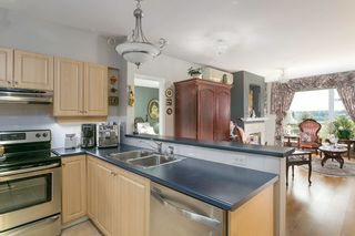 """Photo 3: 419 3629 DEERCREST Drive in North Vancouver: Roche Point Condo for sale in """"DEERFIELD BY THE SEA"""" : MLS®# R2165310"""