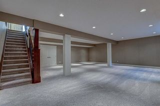 Photo 18: 72 Elysian Crescent SW in Calgary: Springbank Hill Semi Detached for sale : MLS®# A1148526