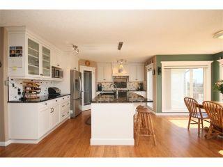 Photo 13: 51 GLENEAGLES View: Cochrane House for sale : MLS®# C4008842