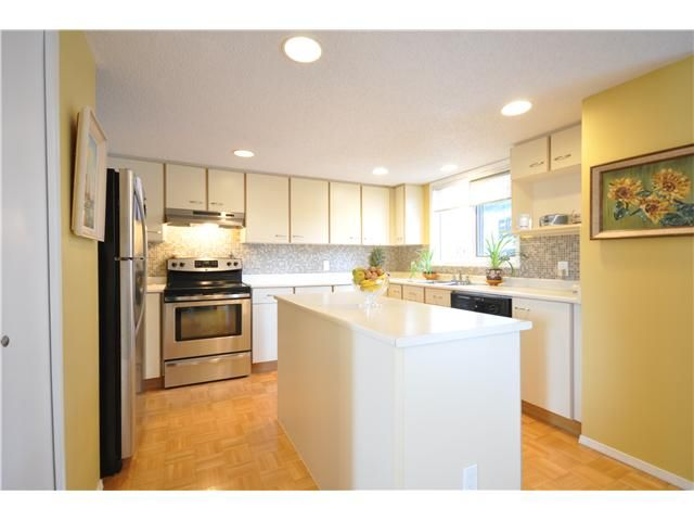 Photo 4: Photos: 27 5810 PATINA Drive SW in CALGARY: Prominence_Patterson Townhouse for sale (Calgary)  : MLS®# C3597559