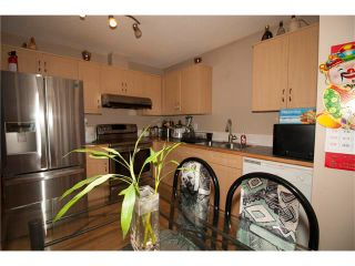 Photo 8: 1001 111 TARAWOOD Lane NE in Calgary: Taradale House for sale : MLS®# C4059766