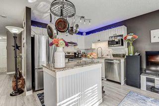 Photo 6: 183 Mt Douglas Manor SE in Calgary: McKenzie Lake Row/Townhouse for sale : MLS®# A1071755