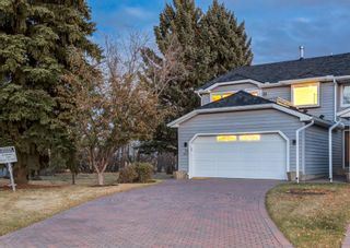 Photo 2: 24 WOOD Crescent SW in Calgary: Woodlands Row/Townhouse for sale : MLS®# A1154480