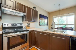 """Photo 5: 211 2109 ROWLAND Street in Port Coquitlam: Central Pt Coquitlam Condo for sale in """"PARK VIEW PLACE"""" : MLS®# R2511516"""