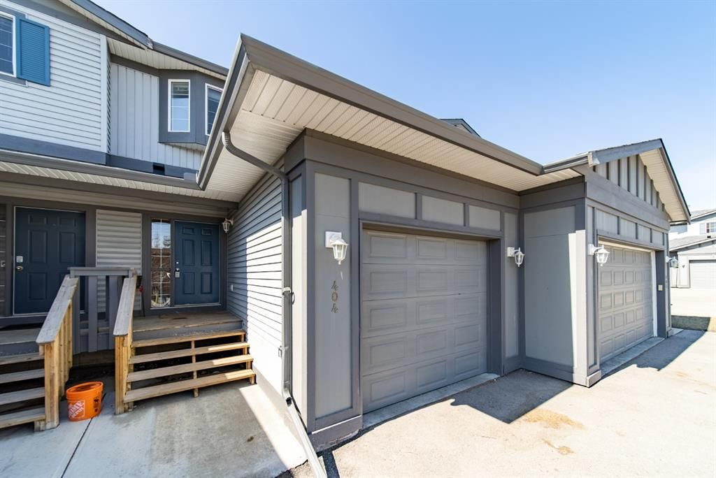 Main Photo: 404 720 Willowbrook Road NW: Airdrie Row/Townhouse for sale : MLS®# A1098346