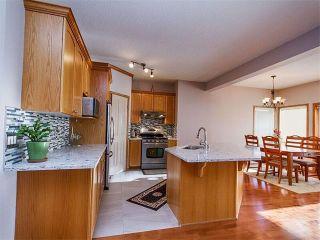 Photo 2: 27 TUSCANY RIDGE Heights NW in Calgary: Tuscany House for sale : MLS®# C4094998