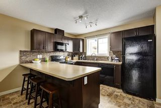 Photo 7: 94 SUNSET Road: Cochrane House for sale : MLS®# C4147363