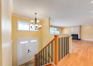 Photo 4: 7308 11 Street SW in Calgary: Kelvin Grove Detached for sale : MLS®# A1100698