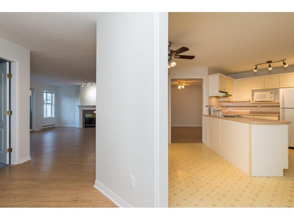 "Photo 18: Photos: 211 12633 72 Avenue in Surrey: West Newton Condo for sale in ""College Park"" : MLS®# R2226813"