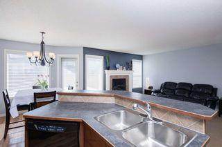 Photo 10: 33 Brightondale Park SE in Calgary: New Brighton Detached for sale : MLS®# A1088765