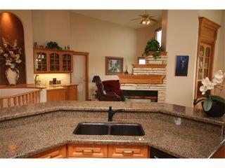 Photo 17: 315 GLENEAGLES View: Cochrane House for sale : MLS®# C4014401