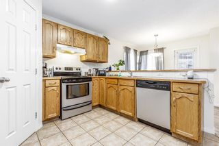 Photo 9: 85 Hidden Creek Rise NW in Calgary: Hidden Valley Row/Townhouse for sale : MLS®# A1104213