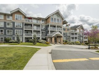 """Photo 2: 102 6460 194 Street in Surrey: Clayton Condo for sale in """"Water Stone"""" (Cloverdale)  : MLS®# R2572204"""