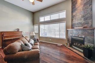 Photo 3: 105 Rocky Ridge Court NW in Calgary: Rocky Ridge Row/Townhouse for sale : MLS®# A1069587