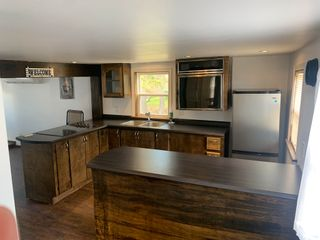 Photo 7: 7542 East Bay Highway in Big Pond: 207-C. B. County Residential for sale (Cape Breton)  : MLS®# 202110775