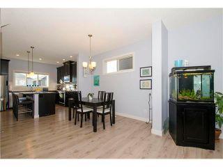 Photo 4: 587 EVANSTON Drive NW in Calgary: Evanston House for sale : MLS®# C4060637