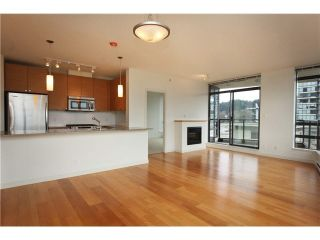 "Photo 1: 404 110 BREW Street in Port Moody: Port Moody Centre Condo for sale in ""ARIA 1"" : MLS®# R2551698"