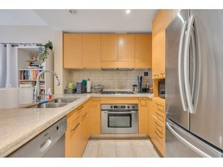 """Photo 3: 102 6015 IONA Drive in Vancouver: University VW Condo for sale in """"Chancellor House"""" (Vancouver West)  : MLS®# R2618158"""