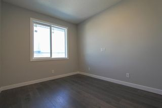 Photo 25: 2410 54 Avenue SW in Calgary: North Glenmore Park Semi Detached for sale : MLS®# A1082680