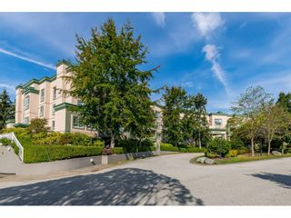 "Photo 1: 331 13880 70 Avenue in Surrey: East Newton Condo for sale in ""Chelsea Gardens"" : MLS®# R2528464"