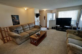 Photo 5: 113 Edgar Avenue NW: Turner Valley Semi Detached for sale : MLS®# A1101043