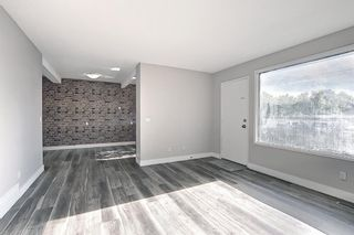 Photo 4: 66 175 Manora Place NE in Calgary: Marlborough Park Row/Townhouse for sale : MLS®# A1121806