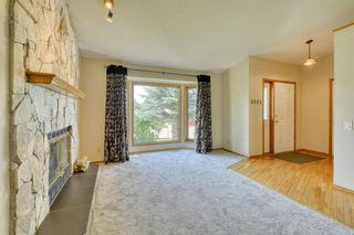 Photo 10: 62 West Mackay Crescent: Cochrane Detached for sale : MLS®# A1127926