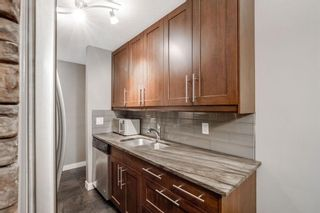 Photo 7: 113 1411 7 Avenue NW in Calgary: Hillhurst Apartment for sale : MLS®# A1034342