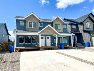 Photo 1: 8720 74 Street in Fort St. John: Fort St. John - City SE 1/2 Duplex for sale (Fort St. John (Zone 60))  : MLS®# R2551656