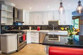 Photo 3: 4 GLENHILL Drive: Cochrane Detached for sale : MLS®# C4301676