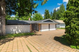Photo 1: 2101 COMO LAKE Avenue in Coquitlam: Chineside House for sale : MLS®# R2546783