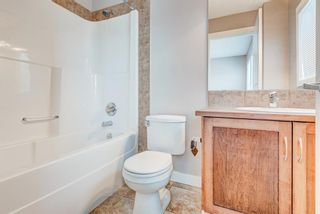 Photo 17: 100 28 Heritage Drive: Cochrane Row/Townhouse for sale : MLS®# A1076913