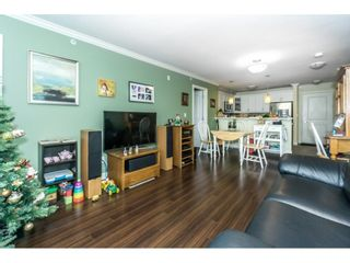 """Photo 10: 407 8084 120A Street in Langley: Queen Mary Park Surrey Condo for sale in """"Eclipse"""" (Surrey)  : MLS®# R2333868"""