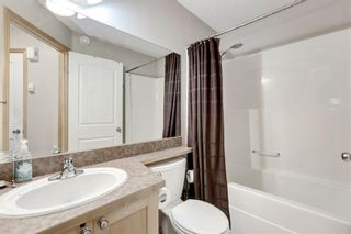 Photo 17: 104 3 EVERRIDGE Square SW in Calgary: Evergreen Row/Townhouse for sale : MLS®# A1143635
