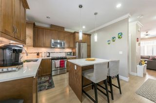 """Photo 10: 2 6929 142ND Street in Surrey: East Newton Townhouse for sale in """"REDWOOD"""" : MLS®# R2354348"""