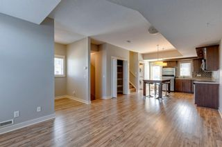 Photo 2: 740 73 Street SW in Calgary: West Springs Row/Townhouse for sale : MLS®# A1138504