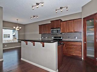 Photo 4: 118 Aspen Hills Drive SW in Calgary: Aspen Woods House for sale : MLS®# C3606583