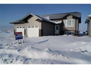 Photo 1: 324 Player Crescent: Warman Single Family Dwelling for sale (Saskatoon NW)  : MLS®# 388449