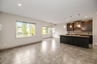 Photo 3: 76 Brightoncrest Rise SE in Calgary: New Brighton Detached for sale : MLS®# A1153438