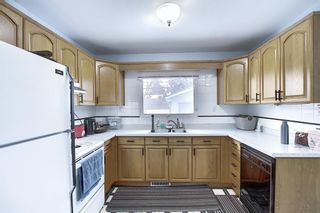 Photo 7: 8019 4A Street SW in Calgary: Kingsland Detached for sale : MLS®# A1063979