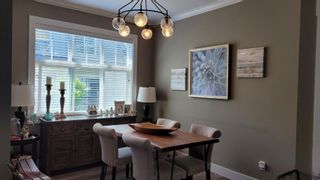 """Photo 1: 48 7171 STEVESTON Highway in Richmond: Broadmoor Townhouse for sale in """"CASSIS"""" : MLS®# R2598748"""