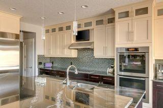 Photo 11: 517 Aspen Glen Place SW in Calgary: Aspen Woods Detached for sale : MLS®# A1100423